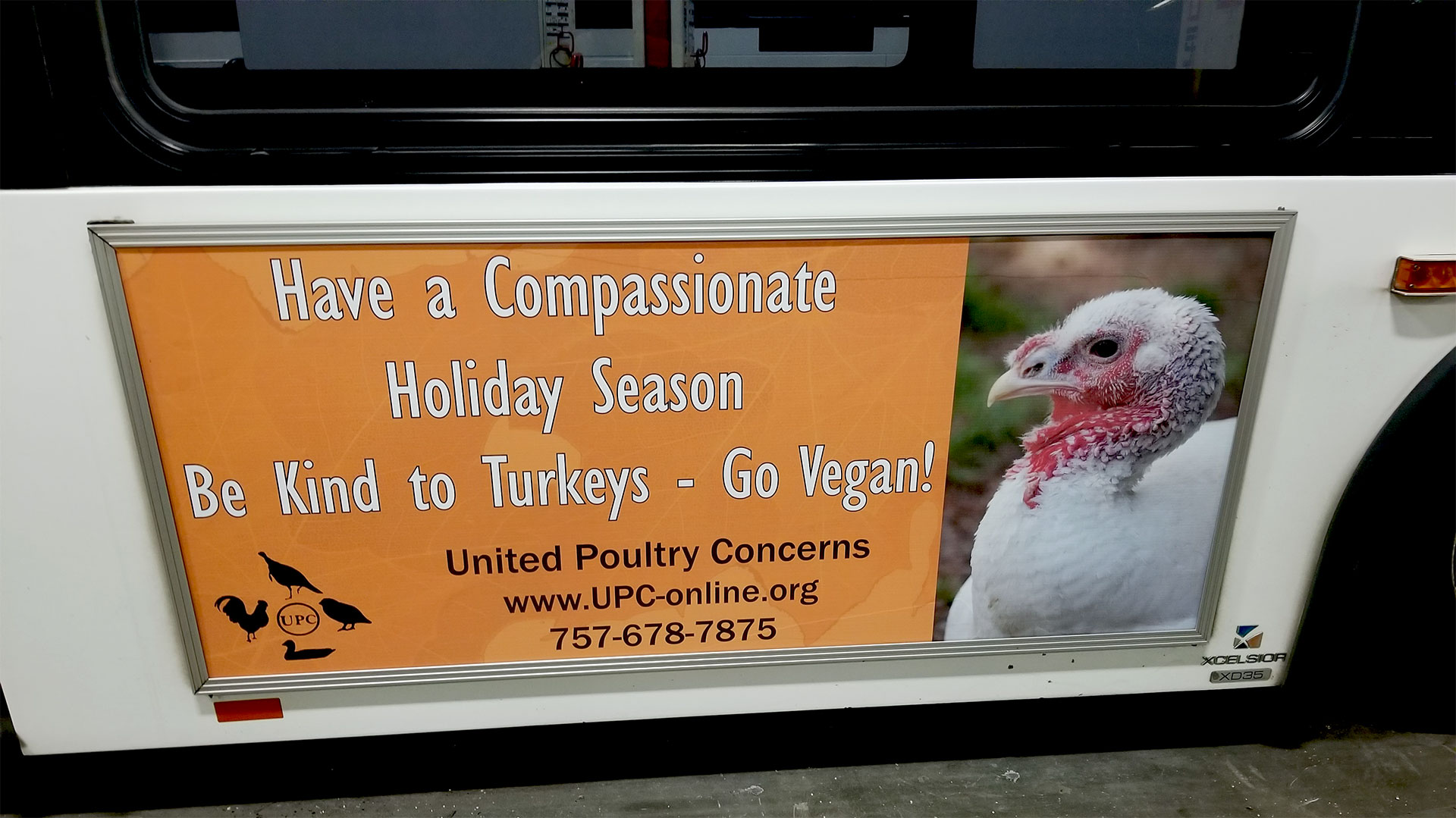Have a compassionate holiday sign on a bus