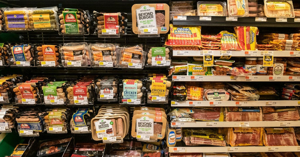 Grocery store shelves filled with packaged meats
