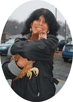 Karen holding a rescued chicken