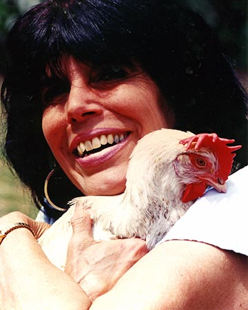 Karen hugging Karla the hen