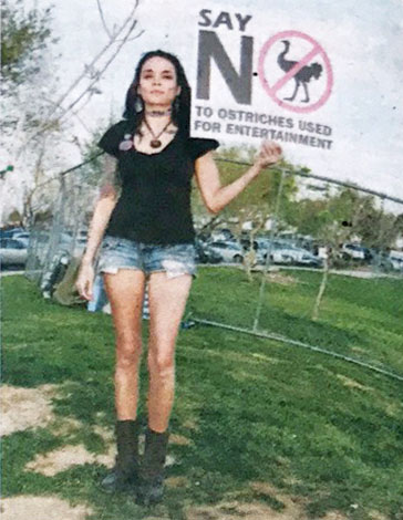 Ostrich race protester holding a sign