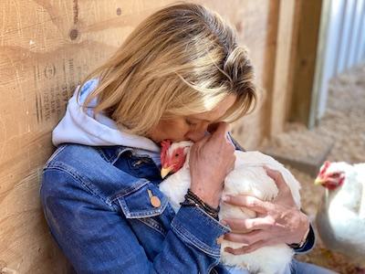 Woman holding a hen
