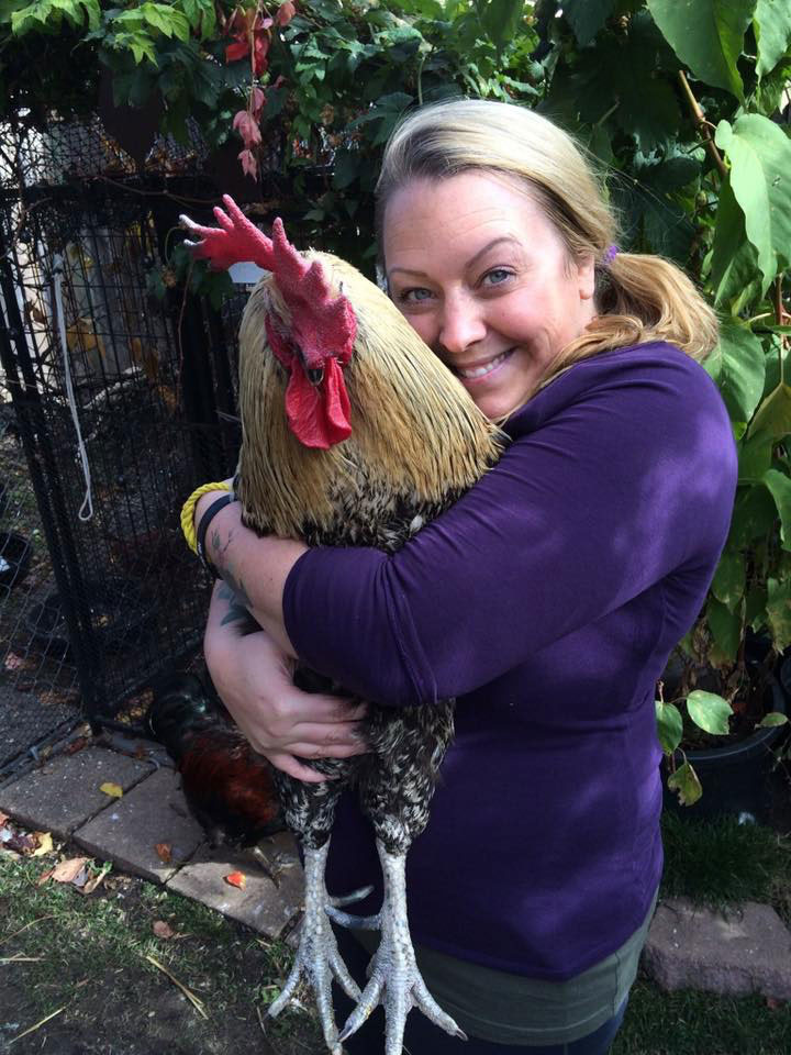 Melanie hugging Butler the rooster